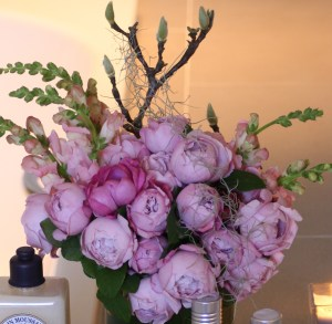Flower arrangement featuring pink peonies, stock and magnolia