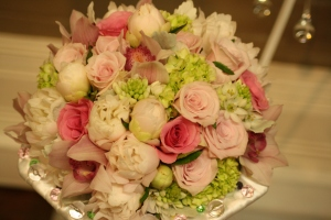 pink and green wedding bouquet in orchids peonies roses dusty miller